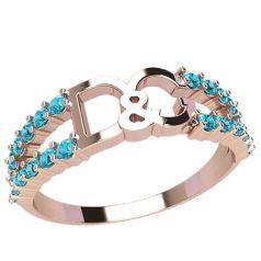 кольцо в красном золоте с голубыми камнями