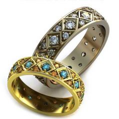 Роскошные обручальные кольца в ромбик с камнями