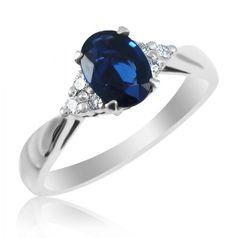 женское кольцо для помолвки с овальным камнем