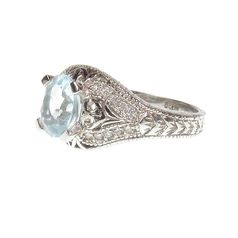 кольцо в белом золоте с топазом и бриллиантами