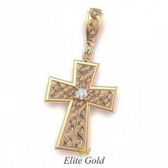 Золотой крест с узорами и камнем