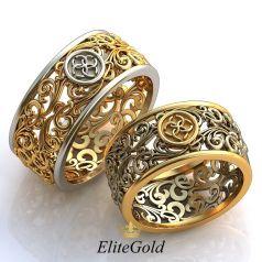 Авторские ажурные обручальные кольца Cassara с символом Свадебник в центре