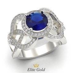 кольцо-многокаменка с крупным синим камнем в белом золоте