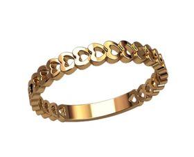 женское кольцо с сердечками