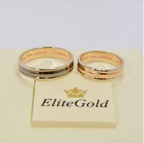 мужское кольцо в белом золоте с черным родажом, женское - в красном и белом золоте