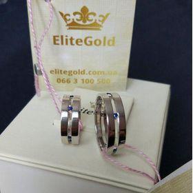 сдвоенные обручальные кольца с камнями в белом золоте с сапфирами