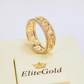женское обручальное кольцо в белом и лимонном золоте с гранатами
