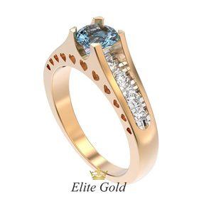 кольцо Isabella в красном и белом золоте с голубым камнем