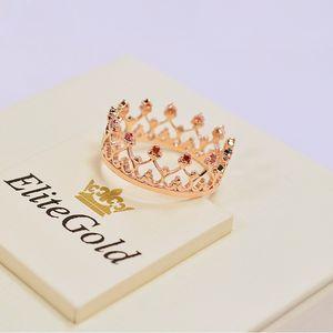 кольцо корона Grace в красном золоте с гранатами