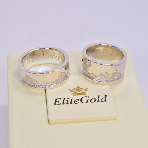 обручальные кольца с рисунком горы в белом золоте