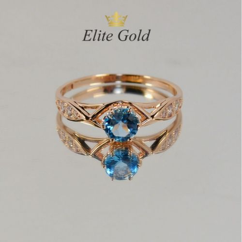 женское кольцо с камнями с топазом в красном золоте