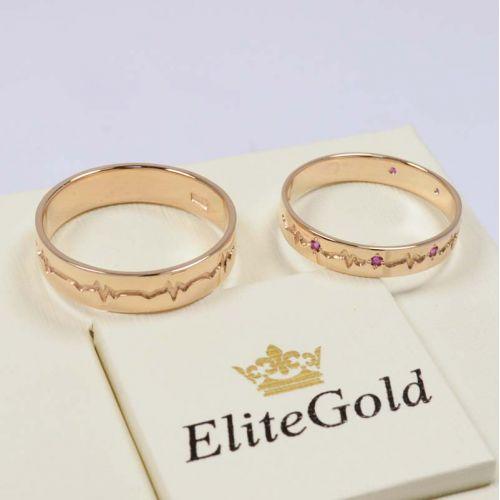кольца Пульс в красном золоте с рубинами