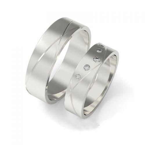 кольца с прорезями и камнями