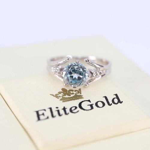 в белом золоте с топазом и бриллиантами