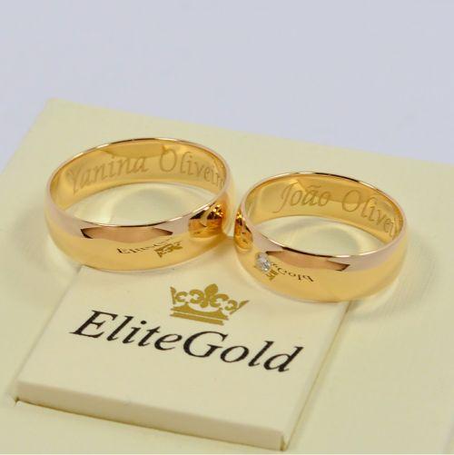 классические обручальные кольца с одним камнем в женском